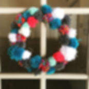 Pom Pom wreath made by our Decoration Ma