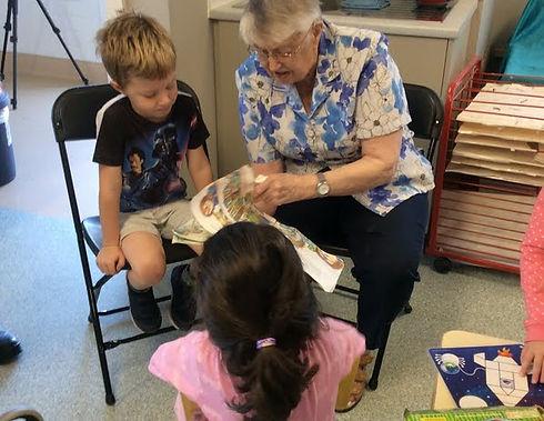 Elderly resident reading to child relationship