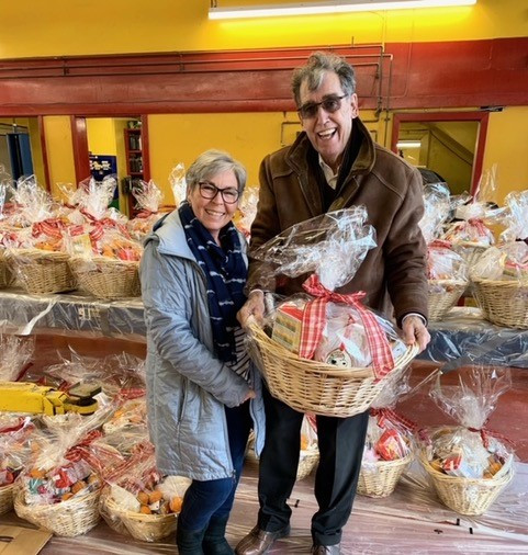 Jim Brousseau, owner of Super Lube delivering Christmas baskets