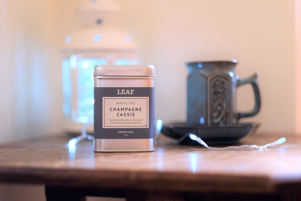 A tin of LEAF'S White Tea Champagne Cassis on a table