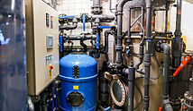 Room with plumbing equipment with pipe c