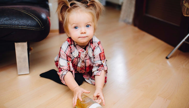 child sitting on the floor playing