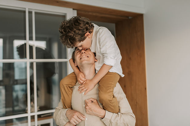 man-carrying-his-son-on-his-shoulders-46