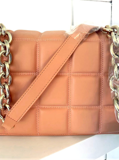 Peach quilted bag with gold chain strap