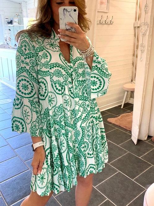 green patterened swing dress