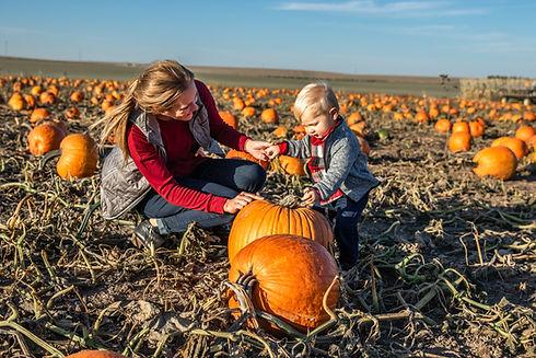 Boy & Mom in Pumpkin Patch.jpg