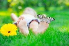 -children-feet-in-green-grass-butterfly-
