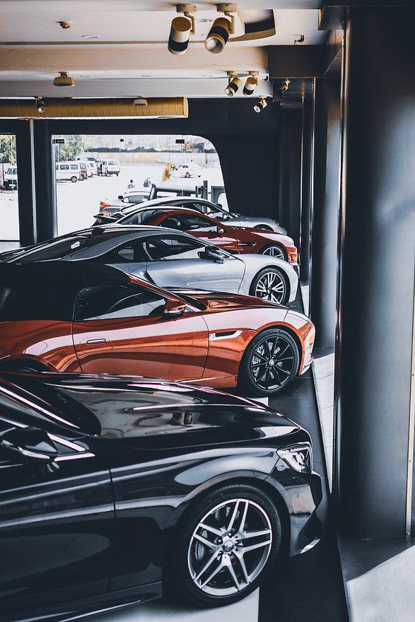black_and_orange_sports_car-scopio-520d54e9-41f3-4960-85e4-835e2f5f1455.jpg