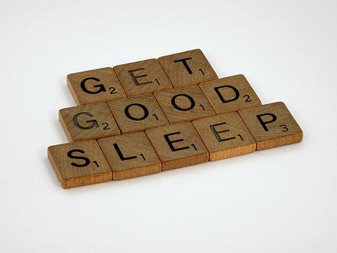 Wooden scrabble tiles reading GET GOOD SLEEP