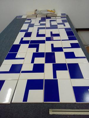 Projeto Leblon - assentamento painel de azulejos Athos Bulcão