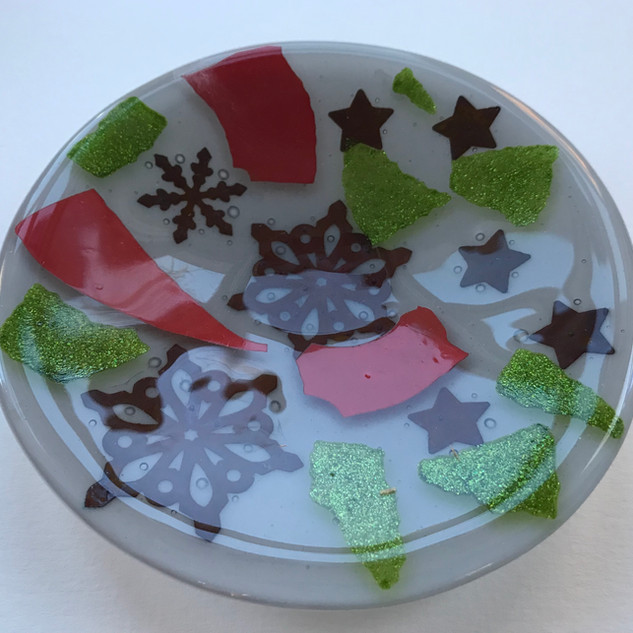Fused glass plate with copper inclusion.