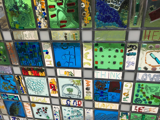 Detail of the fused glass pieces assembled with lead.