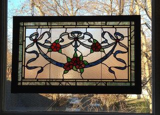 The panel is reglazed with new lead and mended with copper foil.
