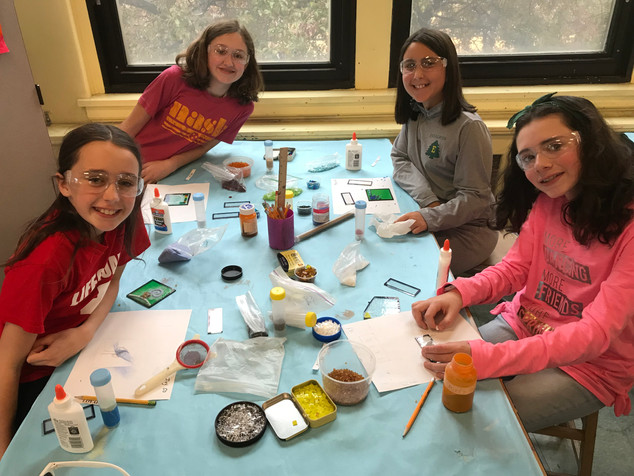 5th graders creating glass tiles prior to kiln-firing.