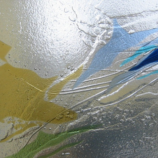 Kiln-formed glass with low relief