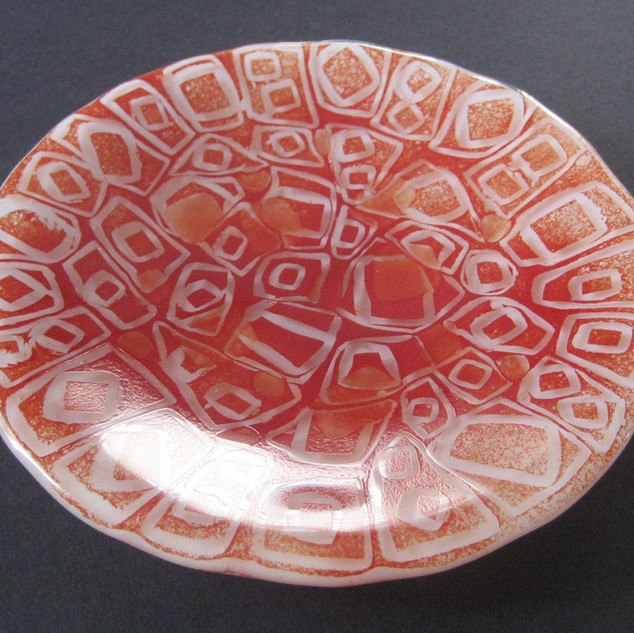 Fused bowl with red glass powder