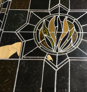 Stained glass window with 2 broken pieces.