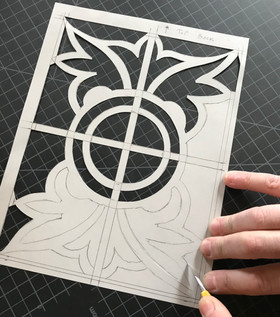 Template created to replicate the painted design for one of the broken piece.