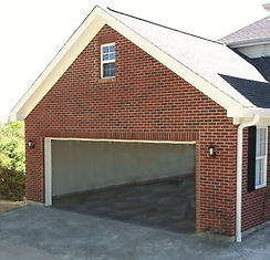 Building attached brick garage in North Carolina.