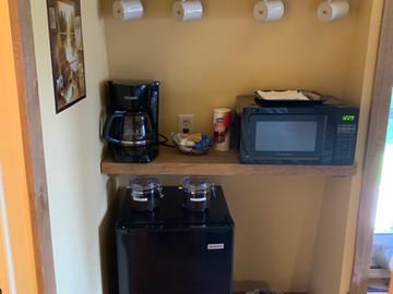 Coffee pot, microwave and refrigerator