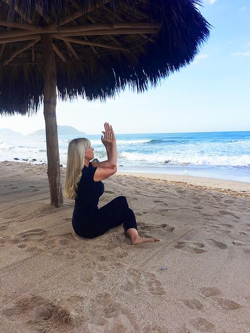 Outdoor Yoga: Sunrise yoga class on the beach in Cerritos Mexico