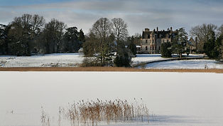 castle-by-lake-in-the-snow-1920x1080.jpg
