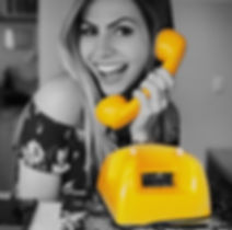 An image of  a person picking up a yellow phone to contact Eleven Inc -yellow representating Eleven Inc