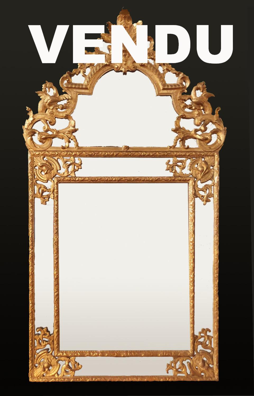 Miroir régence doré à parecloses