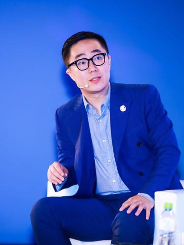 Rufio moderating a panel at Soccerex China