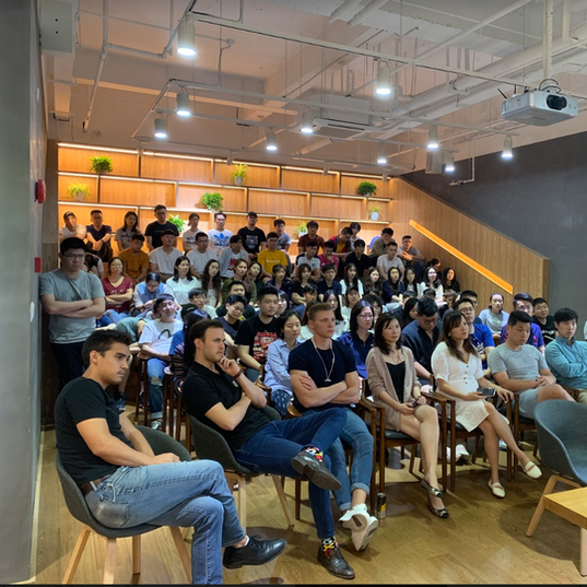 The Team listening intently at a company meeting