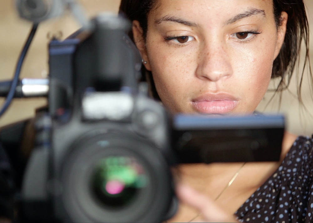 Woman looking into a camera