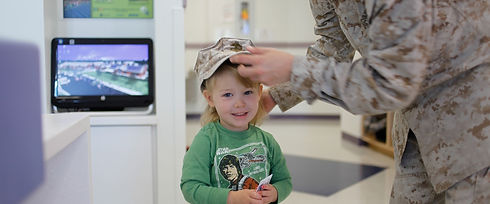 Family Page Marine Placing Cover on Chil