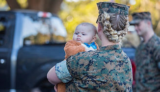 Family Page Marine with Baby by Cpl Debr