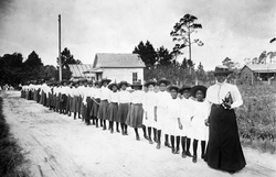 Mary_McLeod_Bethune_with_a_Line_of_Girls