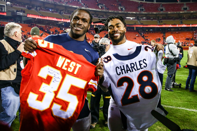 Kansas City Chiefs running back Charcandrick West (35) and Denver Broncos running back Jamaal Charles (25) exchange jerseys