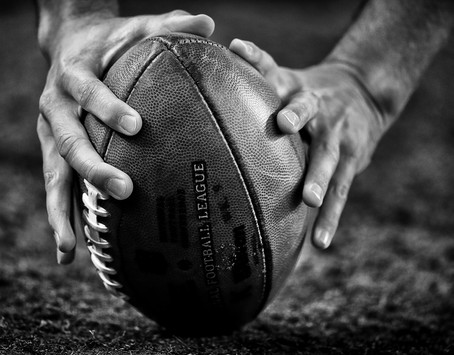 Hands on the football