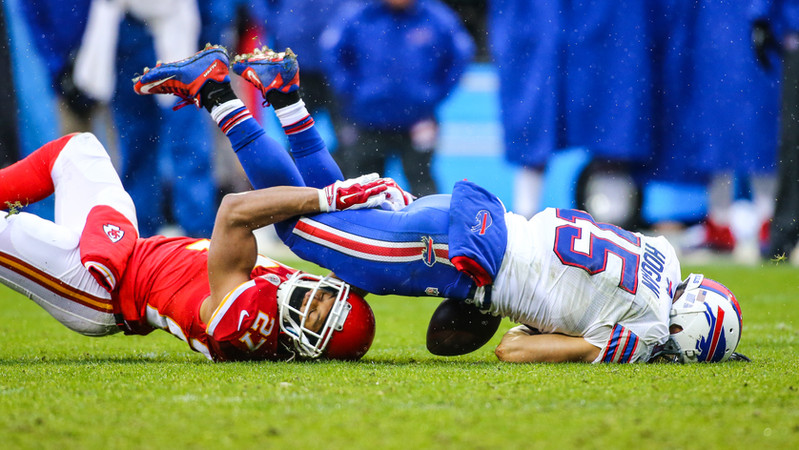 Kansas City Chiefs defensive back Tyvon Branch (27) takes down Buffalo Bills wide receiver Chris Hogan (15)