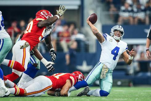 Dallas Cowboys quarterback Dak Prescott (4) is sacked by Kansas City Chiefs linebacker Frank Zombo (51)