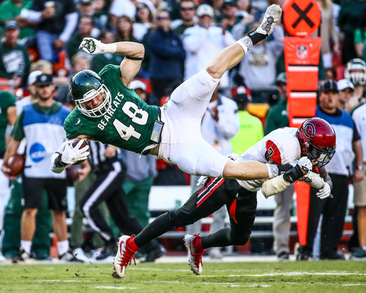University of Central Missouri Mules defensive back Travion Vaughn (3) catches Northwest Missouri State University Bearcats tight end Clayton Wilson (48) by the foot at the Fall Classic football game at Arrowhead Stadium in 2016