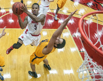 University of Central Missouri Mules guard Rakeem Dickerson (5) leaps to score against his opponent