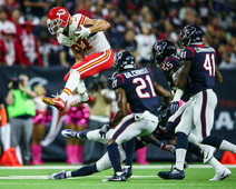 Kansas City Chiefs tight end Travis Kelce (87) leaps over the Housto Texans defense