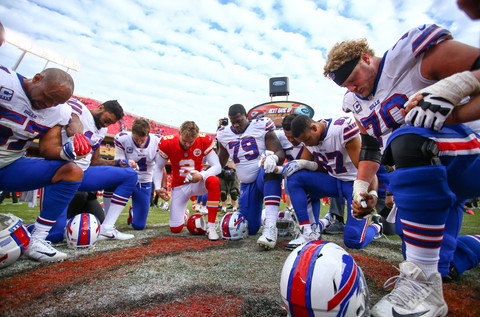 Players join together in prayer following the Buffalo Bills vs Kansas City Chiefs game