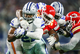 Dallas Cowboys running back Ezekiel Elliott (21) is tackled by Kansas City Chiefs defensive lineman Chris Jones (95)