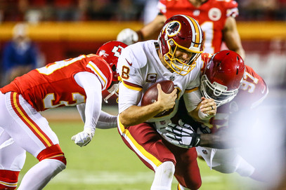Washington Redskins quarterback Kirk Cousins (8) is sacked by Kansas City Chiefs defensive lineman Allen Bailey (97)
