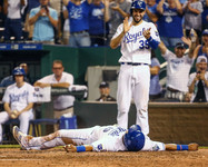 Kansas City Royals first baseman Eric Hosmer (35) stands at home plate cheering for catcher Salvador Perez (13)