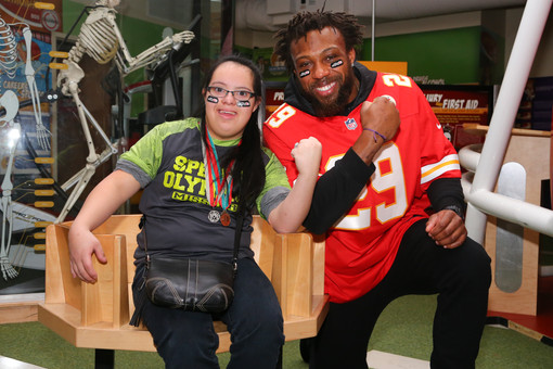 Kansas City Chiefs safety Eric Berry (29) poses for a photo with a Special Olympics athlete in the Chiefs Sports Lab at Arrowhead Stadium