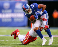 Kansas City Chiefs linebacker Derrick Johnson (56) tackles New York Giants tight end Evan Engram (88) forcing a fumble