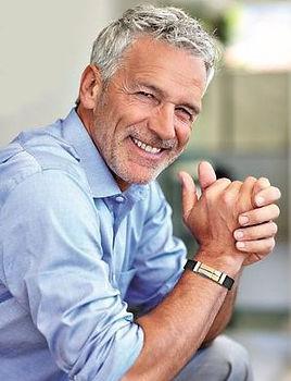 Man plays golf and wear sports magnetic bracelet, Magnetix Wellness in Australia
