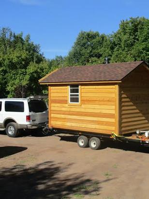 sauna on trailer behind excursion.jpg