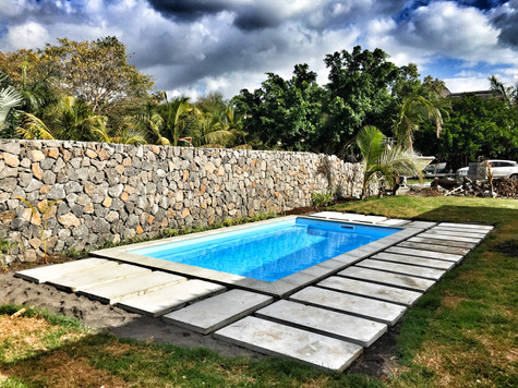 Fibreglass pool with concrete slabs